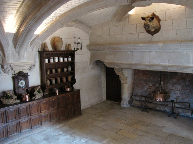Kitchen old world decor massive fireplace mounted boars for French chateau kitchen designs